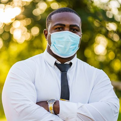 Business man posing with mask on